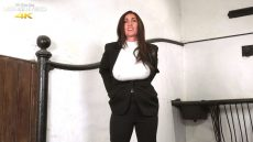 Miss Hybrid leg up against the wall, easy access jodhpurs, masturbating.