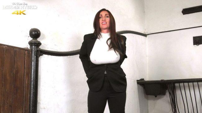 Miss Hybrid leg up against the wall, easy access jodhpurs, masturbating.